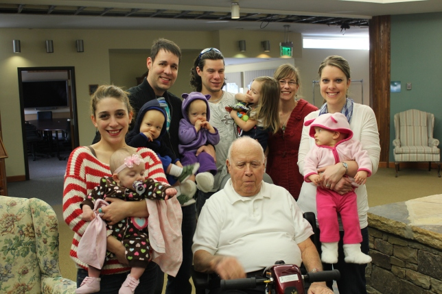 All the grandkids and great-grandkids that were able to be there. LtoR: Bekah and Brighton, David and Noah and Emma, Travis (cousin) with Meadow and Kellie and me with Makenna and Grandpa in the front!