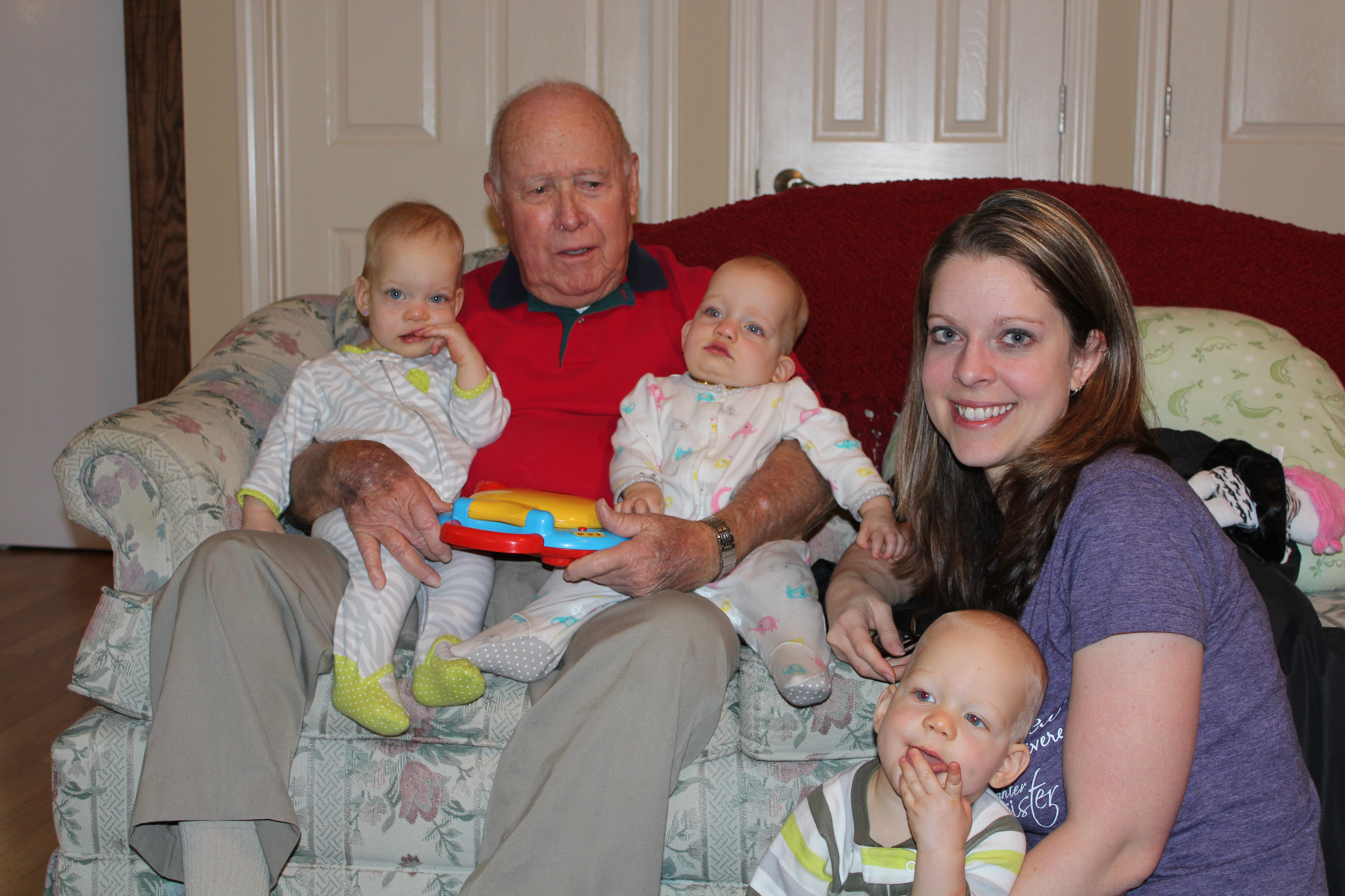 """Meeting his """"great-grand-triplets"""" for the first time. Thanksgiving 2012."""