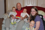 "Meeting his ""great-grand-triplets"" for the first time. Thanksgiving 2012."