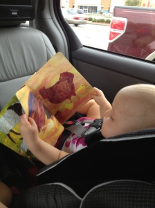 Makenna chillaxin' in the car with a book - girl after my own heart!