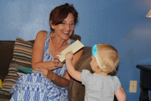 The babies began passing out the cards to the mommies.